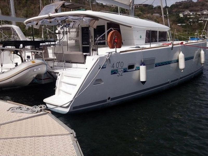 Catamaran Lagoon 400 moored in a Greek harbor during a bareboat yacht rental holiday